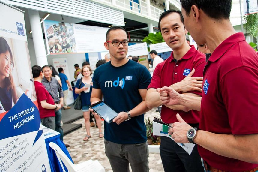 Dr Koh Poh Koon (middle), Minister of State, Ministry of National Development and Ministry of Trade and Industry, learning about MyDoc from Dr Lim Jui (right), CEO of NTUitive, Nanyang Technological University's innovation and enterprise arm and Mr C