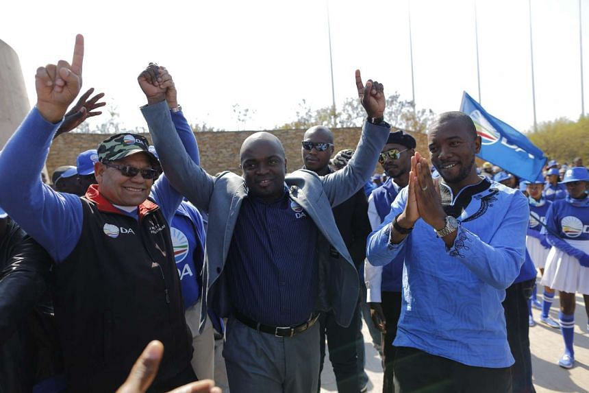 New major of Tshwani, Solly Msimanga (centre) of the Democratic Alliance together with national leader, Mmusi Maimane (right) arrive at a victory rally held at Freedom Park, Pretoria, South Africa on Aug 9, 2016.