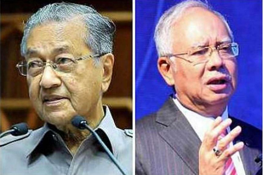 Prime Minister Najib Razak (right) has taken a fresh swipe at Tun Dr Mahathir Mohamad's (left) often confrontational foreign policy approach when he was Malaysia's leader for 22 years.