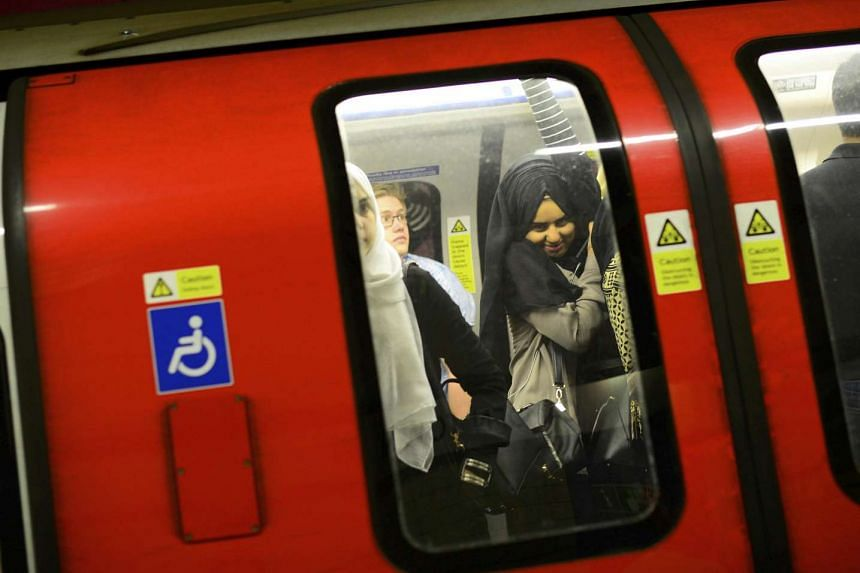 Commuters travel on the northern line on the London underground in London.