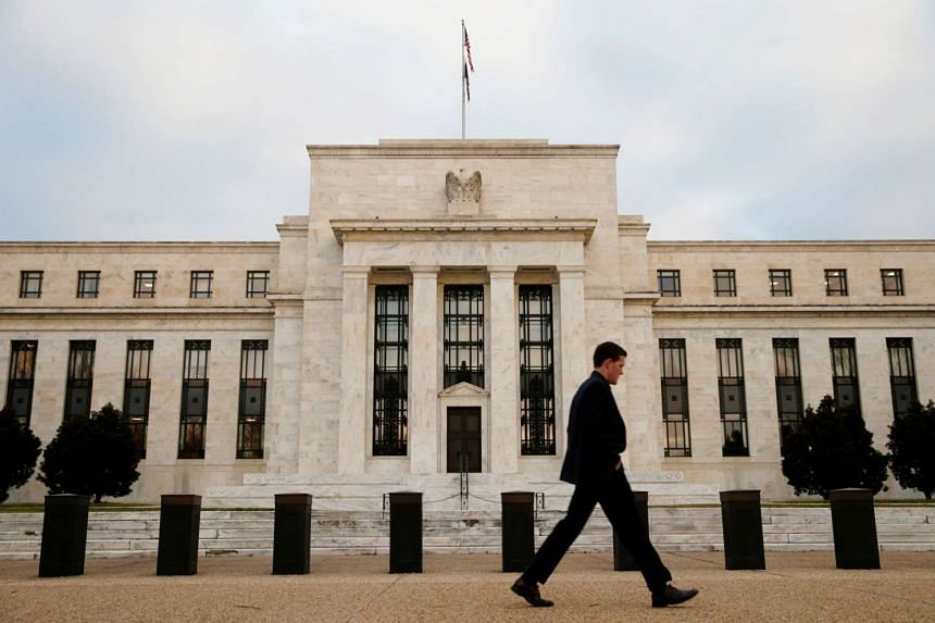 A man walks past the Federal Reserve Bank in Washington DC.