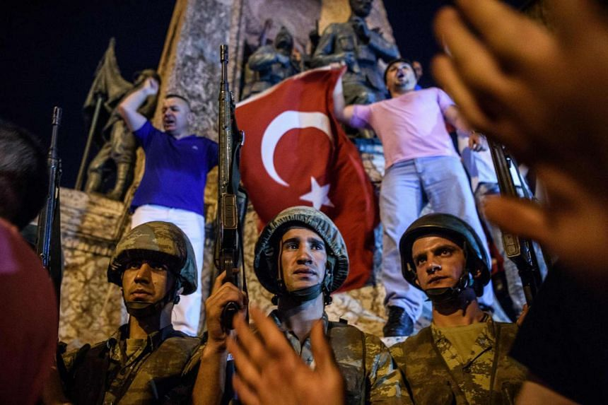 Turkish soldiers staying at Taksim square as people react in Istanbul as Turkish military opened fire on crowds gathered in Istanbul following a coup attempt on July 16.