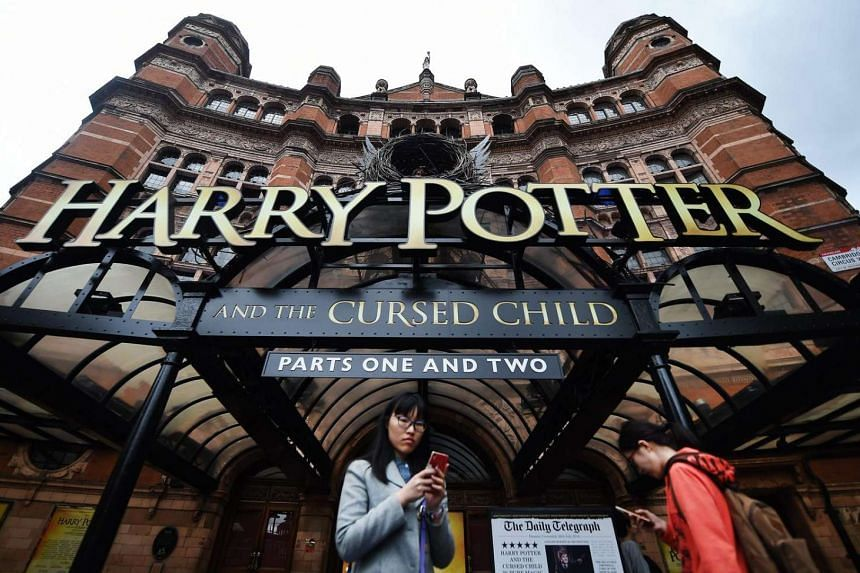 Harry Potter fans using mobile phones outside the Palace Theatre in London, Britain, which stages British writer J.K. Rowling's play 'Harry Potter and the Cursed Child'.