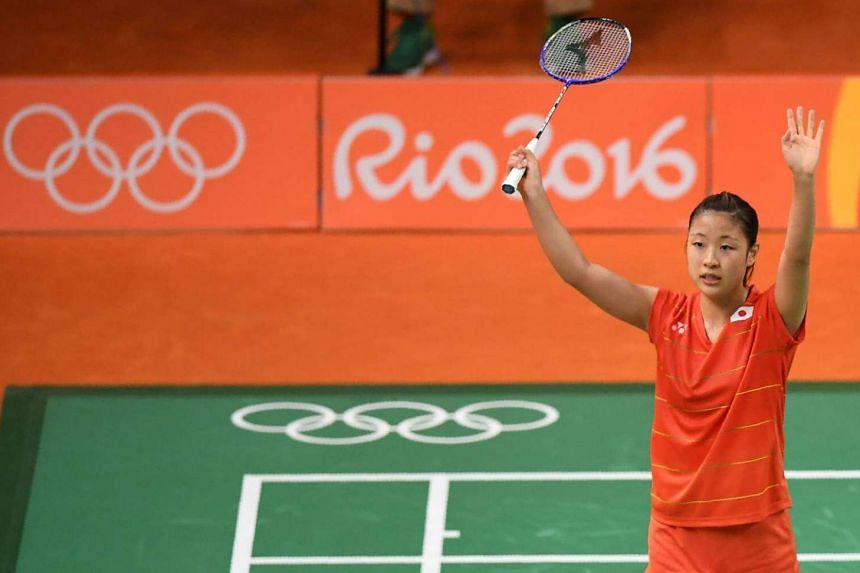 Japan's Nozomi Okuhara reacts after winning against Japan's Akane Yamaguchi during their women's singles quarter-final badminton match at the Riocentro stadium in Rio de Janeiro on August 16.