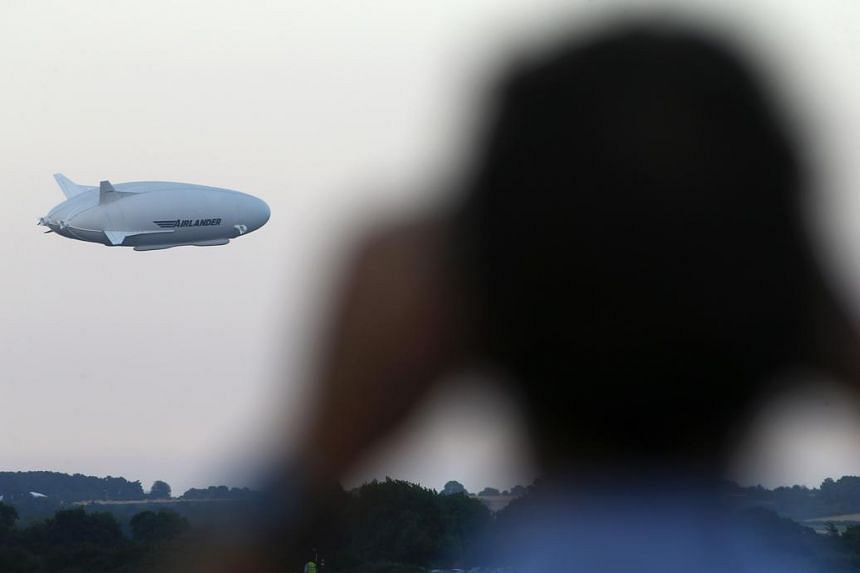 The Airlander 10 hybrid airship is seen in the air on its maiden flight from Cardington Airfield near Bedford, north of London, on Aug 17, 2016.