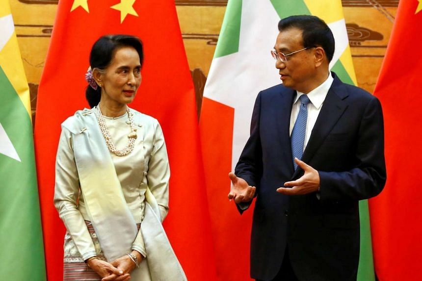 Myanmar State Counsellor Aung San Suu Kyi (left) and Chinese Premier Li Keqiang talk during a signing of agreements ceremony in Beijing.