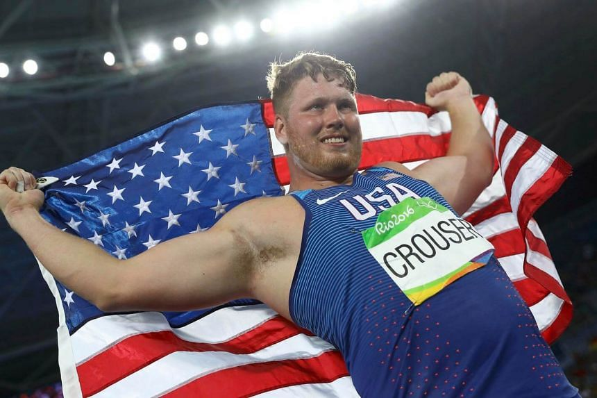 Ryan Crouser of the US celebrates winning the gold medal and setting a new Olympic record for the Men's Shot Put.