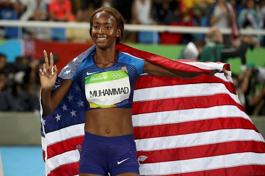 Dalilah Muhammad of the US celebrates after winning the women's 400m hurdles.