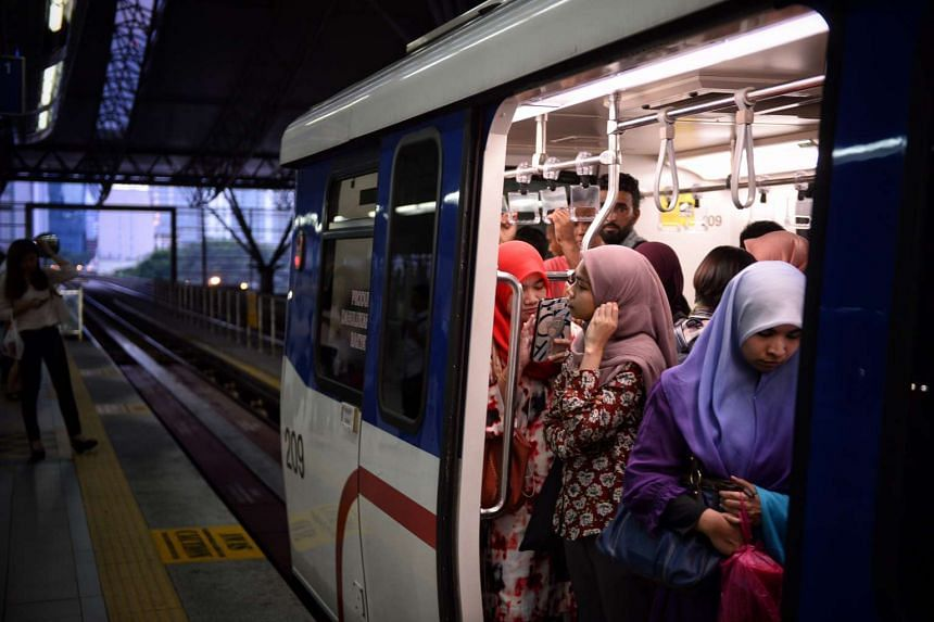 Commuters seen on an LRT train at KL Sentral station in Kuala Lumpur, Malaysia, on July 19, 2016.
