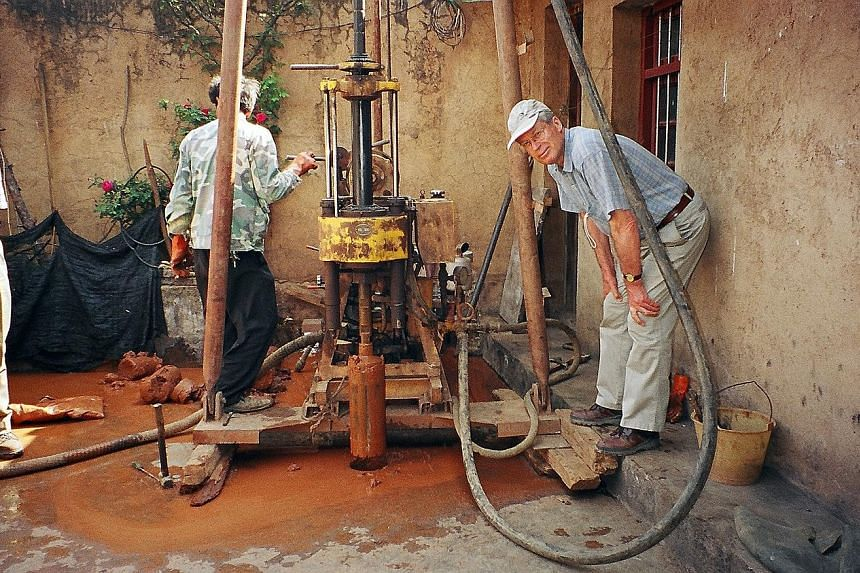 Prof Cherry (right) working in China on a portable drill prototype for extracting safe drinking water from bedrock for isolated communities in developing countries.