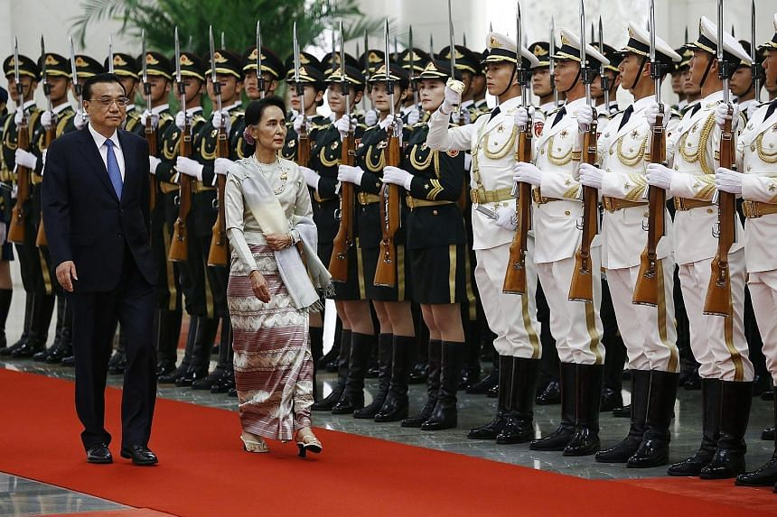 Mr Li and Ms Suu Kyi inspecting a guard of honour during a welcome ceremony yesterday at the Great Hall of the People in Beijing. Ms Suu Kyi is on a five-day visit to China which began on Wednesday, the first country she has visited outside South-eas