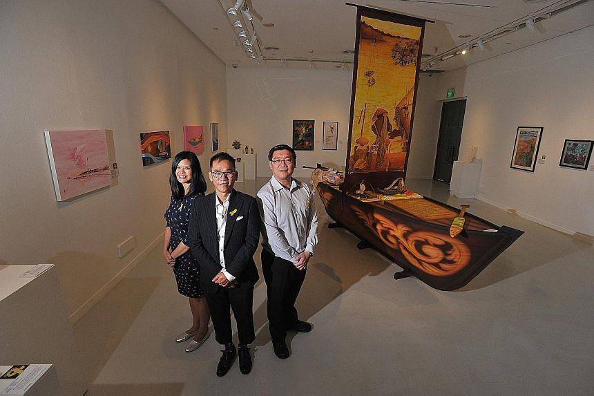 (From left) Singapore Art Museum assistant curator Andrea Fam, the exhibition's artist-in-residence Barry Yeow, and superintendent of prisons Edwin Goh. The boat is the centrepiece of the show and a joint work by inmates from Changi Prison Complex an