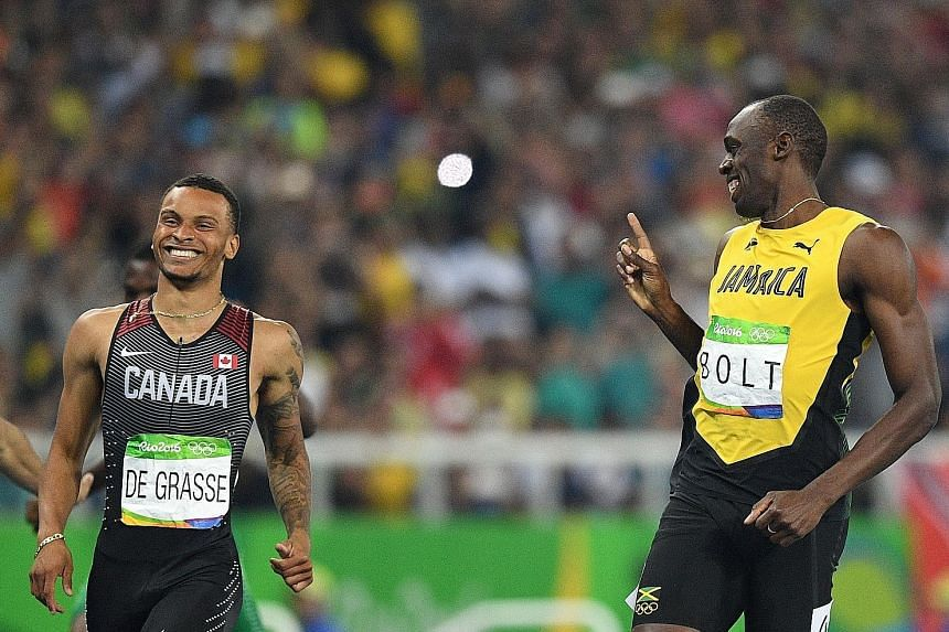 Jamaica's Usain Bolt sharing a laugh with Andre De Grasse as the Canadian made a late attempt to snatch the 200m lead. American Justin Gatlin (in blue) will not be a threat to that record, after failing to qualify for the final.