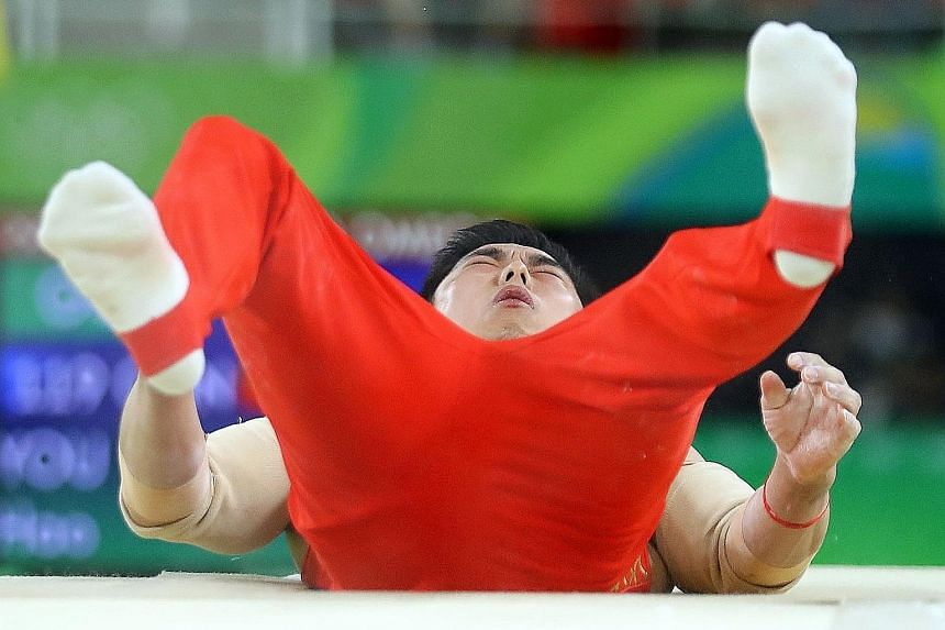 China's You Hao falling in the parallel bars final to finish last. Two gymnastics bronzes from the men's and women's team events are all they had to show for their exploits in Rio.