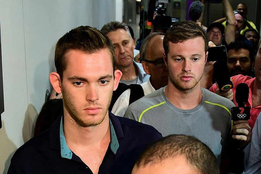 Americans Gunnar Bentz (left) and Jack Conger leaving the police station at Rio's international airport. A judge found discrepancies in the swimmers' accounts of the robbery and had ordered them to be detained for further questioning.