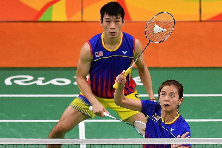 Right: Fans cheering gold medallists Tontowi Ahmad and Liliyana Natsir before they received their gold medals - Indonesia's first in badminton mixed doubles. Left: Malaysia's Goh Liu Ying and Chan Peng Soon were outclassed but not embarrassed in the