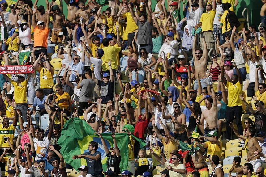Top: Neymar celebrating his second goal - and Brazil's last - against Honduras. He had also opened the scoring in the 15th second, the fastest goal ever scored at the Olympics. Left: Brazil's supporters had much to cheer at the Maracana on Wednesday.
