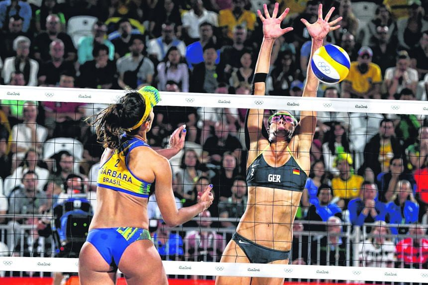 Germany's Kira Walkenhorst blocking Brazil's Barbara Seixas de Freitas in the beach volleyball final at the Copacabana. Walkenhorst and Laura Ludwig upset the home side's Seixas and Agatha Bednarczuk 22-20, 21-18 to take the gold medal.