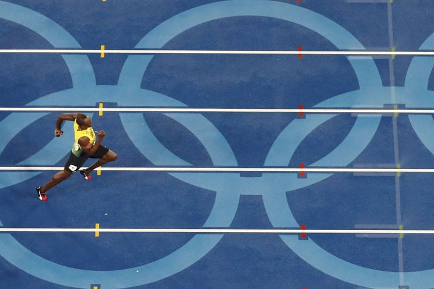 Usain Bolt on his way to winning the gold medal.