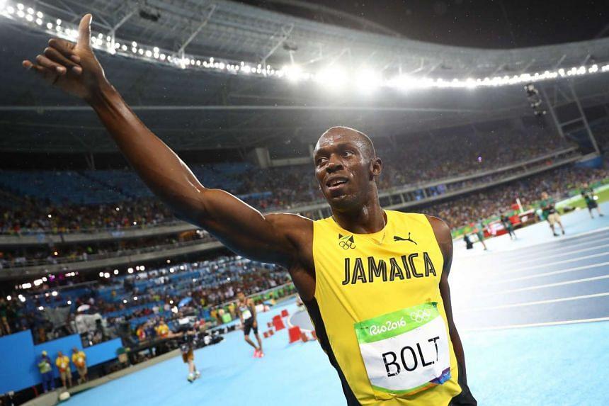 Usain Bolt celebrating after winning his gold medal.
