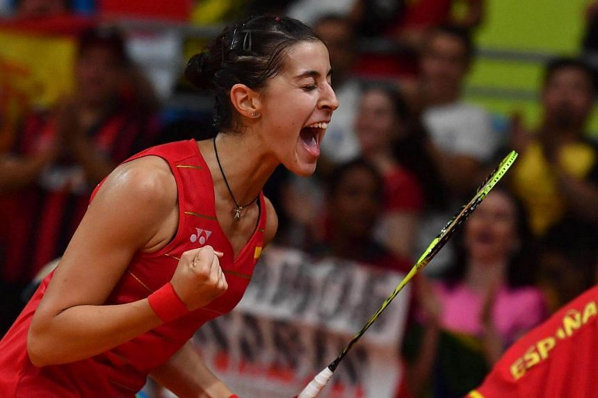 Spain's Carolina Marin reacts after winning against China's Li Xuerui during their women's singles semi-final badminton match on August 18.