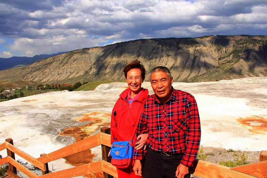 Chen Aiwu, 64, and her husband, Wang Dongsheng, 66, at Yellowstone Park in June.