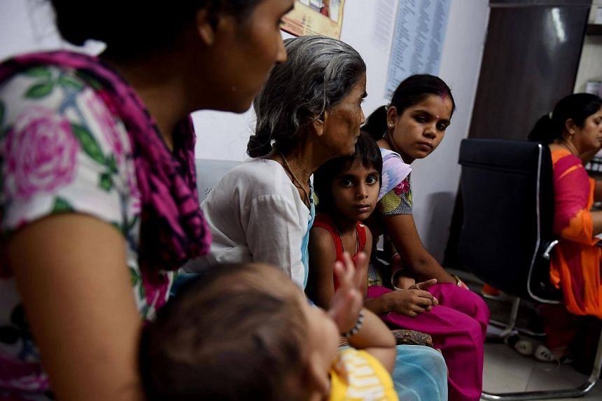 Indian patients wait for their turn to see the doctor at a Mohalla clinic (neighbourhood clinic) in New Delhi.
