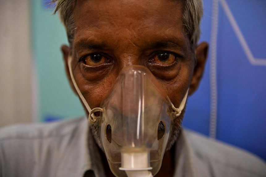 62 year-old Indian asthma sufferer Mohan Lal breathes through a nebuliser at a clinic in his neighbourhood in the slums of New Delhi.