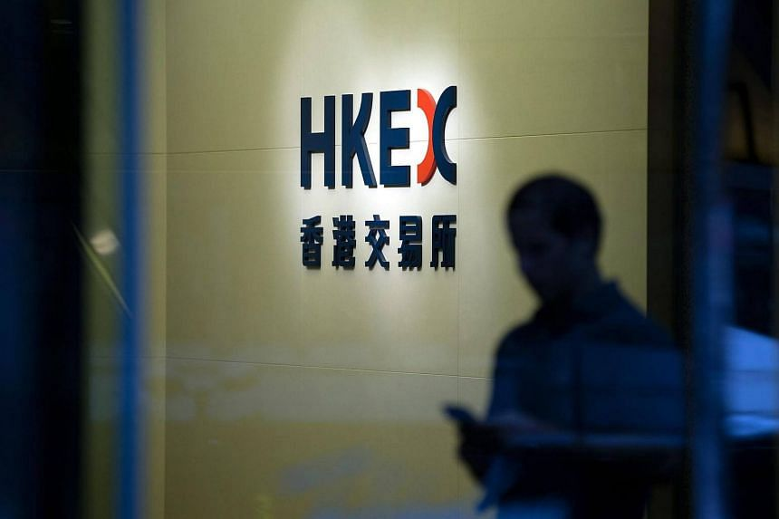 A man walks past the entrance to the Hong Kong Exchanges and Clearing in Hong Kong.