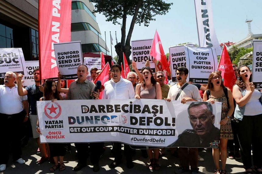 Members of Patriotic Party protesting against the visit of American General Joseph Dunford, chairman of the US joint chiefs of staff, in front of the US embassy in Ankara on Aug 1.