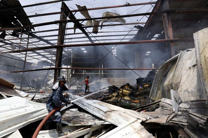 Yemeni firefighters extinguish fire at a food factory allegedly targeted by a Saudi-led airstrike in San'a, Yemen on Aug 9.