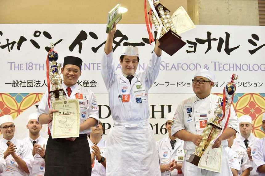 Hideji Celso Amano (centre), a Brazilian of Japanese ancestry, celebrates his win during the award ceremony of the World Sushi Cup Japan 2016 in Tokyo on Aug 19.