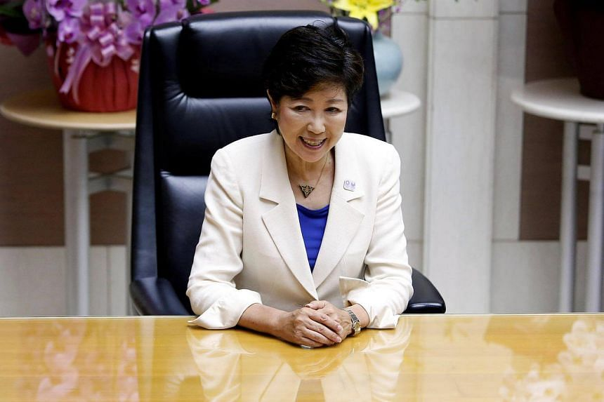 Tokyo's first woman governor Yuriko Koike smiles at her office as she poses for the media at Tokyo Metropolitan Government Building in Tokyo on August 2.