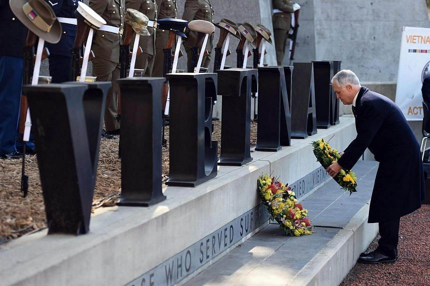 Australian Prime Minister Malcolm Turnbull lays a wreath at a ceremony to mark the 50th anniversary of the Battle of Long Tan at the Australian War Memorial in Canberra.