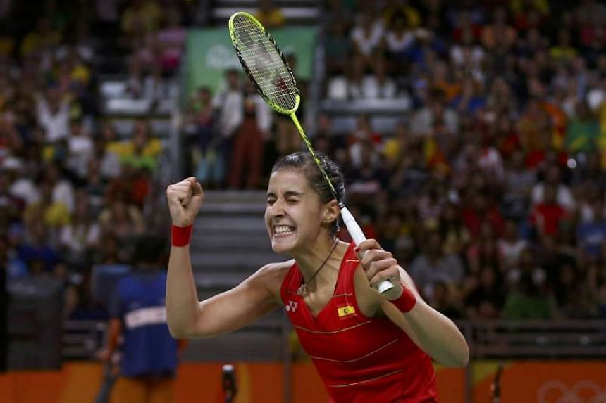 Carolina Marin of Spain celebrates winning her match against India's Pusarla Sindhu.
