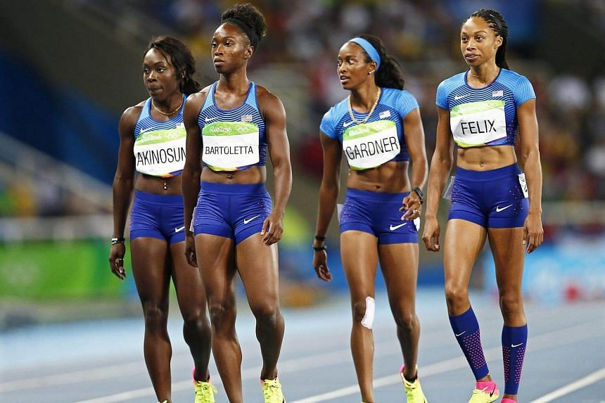 The American quartet of (from left) Morolake Akinosun, Tianna Bartoletta, English Gardner, and Allyson Felix of the US react after competing in the women's 4x100m relay heat.