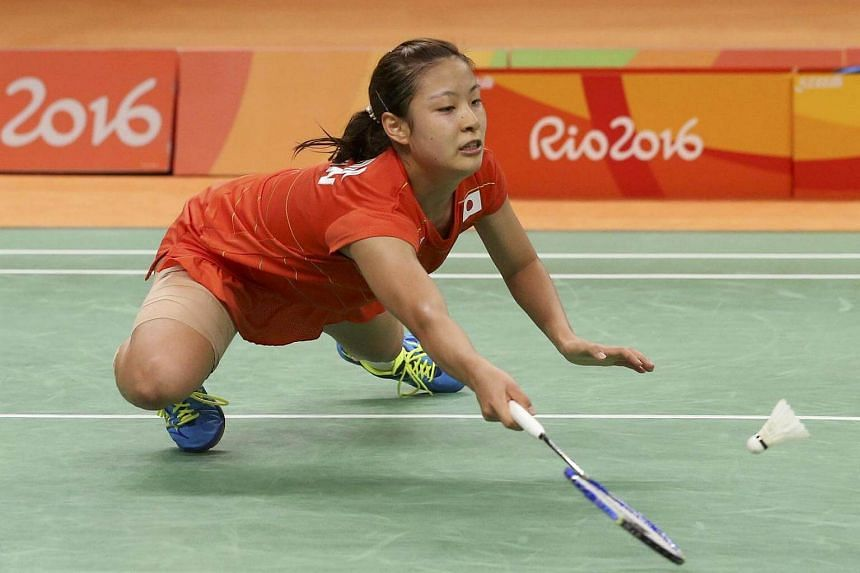 Nozomi Okuhara of Japan reaches for a shot.