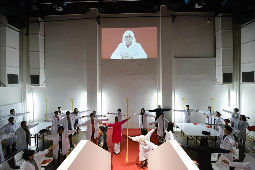 Participants in white lab coats are guided through exercises and tasks by facilitators in coloured lab coats, during the 4 hour participatory piece of performance art I Am LGB.