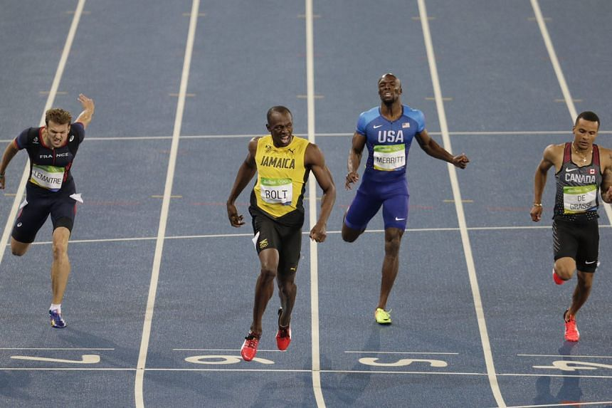 Usain Bolt already celebrating as the 200m race ends.