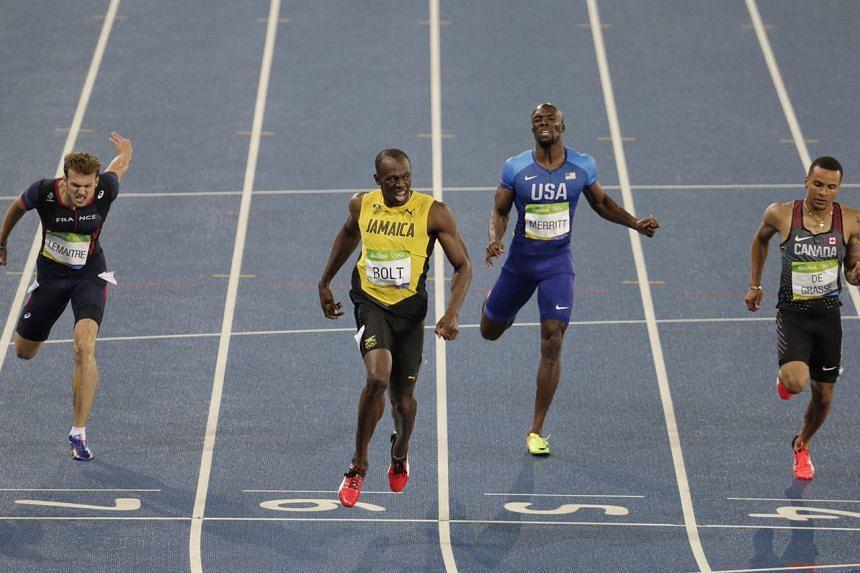 Usain Bolt already celebrating as the 200m race ends.