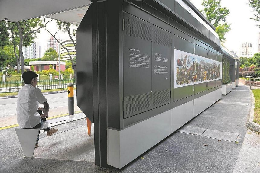 Art panels are seen at the back of the bus stop.