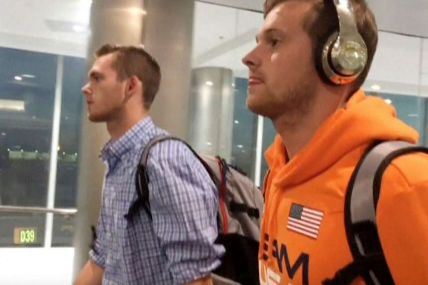 US swimmers Jack Conger and Gunnar Bentz arrive on an overnight flight from Brazil to Miami on Aug 19, 2016.