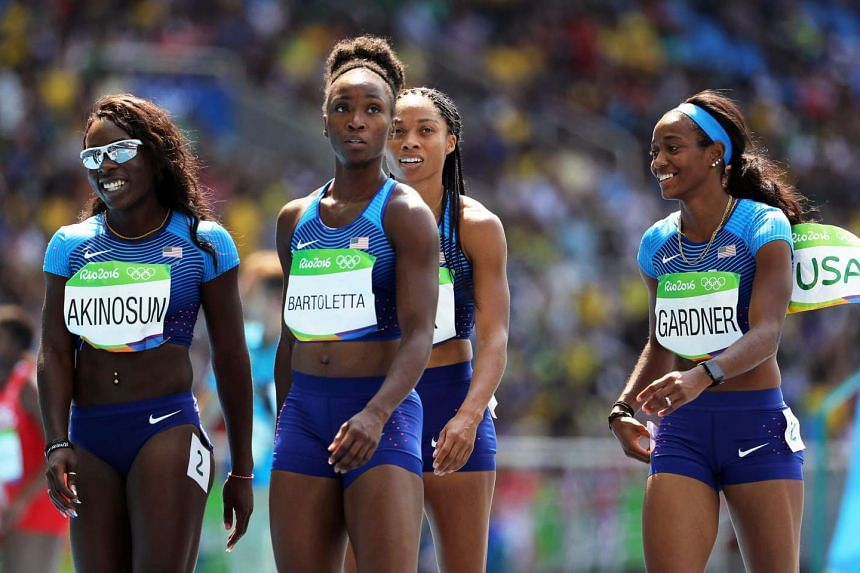 (From left) Morolake Akinosun, Tianna Bartoletta, Allyson Felix, and English Gardner react after competing in the women's 4x100m relay heats.