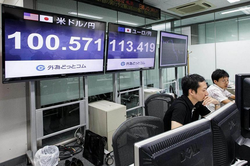 Tokyo money traders work during the morning trading session in Tokyo, Japan on August 17.
