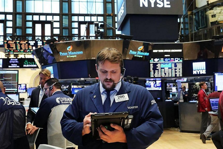 Traders on the floor of the New York Stock Exchange on June 28.