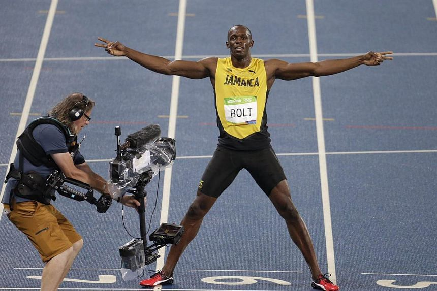 Usain Bolt celebrating his win in front of the camera after defending his 200m title.