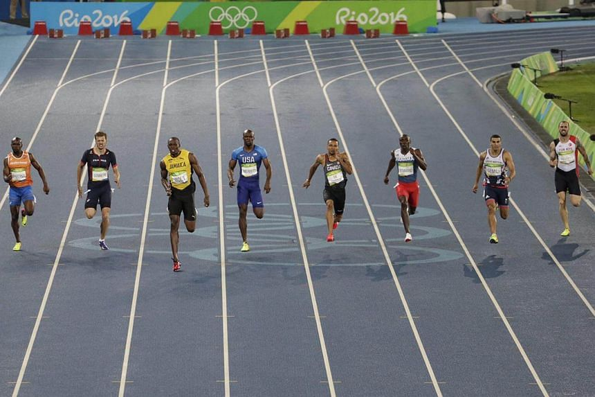 Jamaica's Usain Bolt (third from left) leading during the men's 200m race.