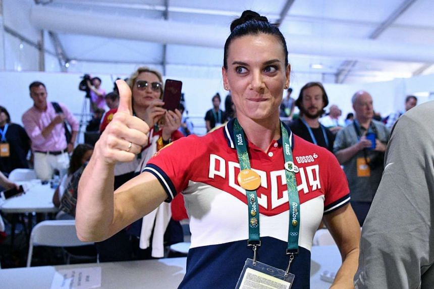 Russian pole vaulter Yelena Isinbayeva gestures during the IOC election result press briefing on Aug 18, 2016.