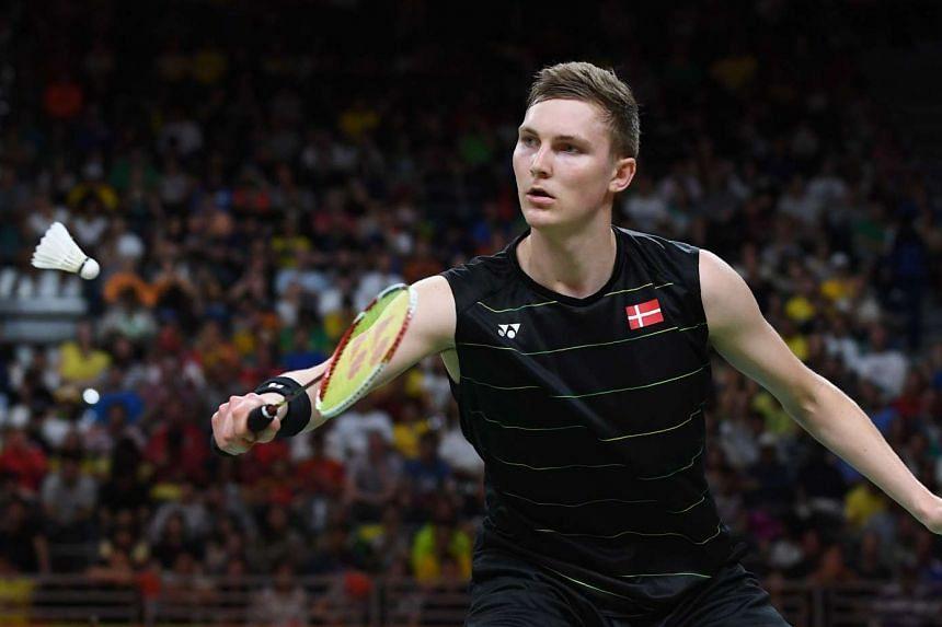 Denmark's Viktor Axelsen returning against China's Chen Long during their men's singles semi-final.