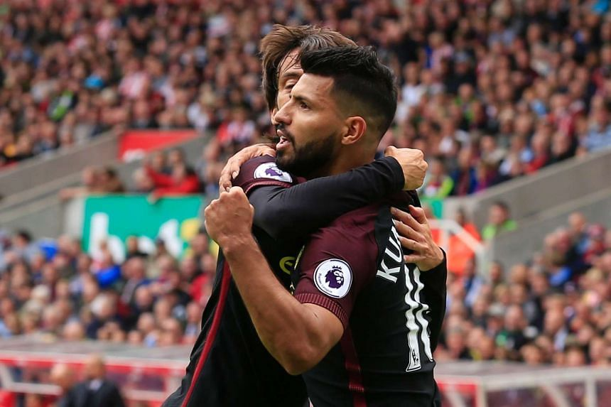 Manchester City's Sergio Aguero celebrating with David Silva after scoring against Stoke City.